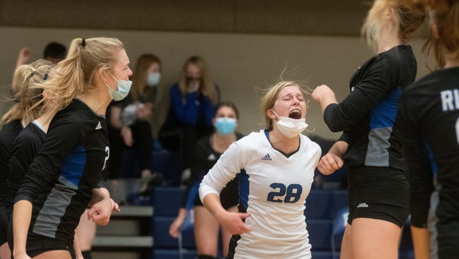 Washburn Rural's Katie Borough (28) yells out in celebration to a point against Wichita Northwest on Tuesday at their home court. Rural advances to the final four for the Class 6A State Games Friday in Salina.