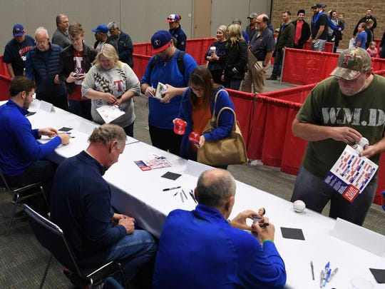 Members from the Texas Rangers gave autograph Friday afternoon at the Wichita Falls Multipurpose Event Center during the team winter caravan. The team member stopped in Wichita Falls for media interviews and to meet the fans before going to Sherman/Denison. The Texas Rangers spring training begins in late February.
