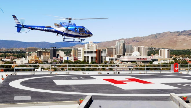 A Care Flight helicopter prepares to land on the roof of Renown Regional Medical Center.