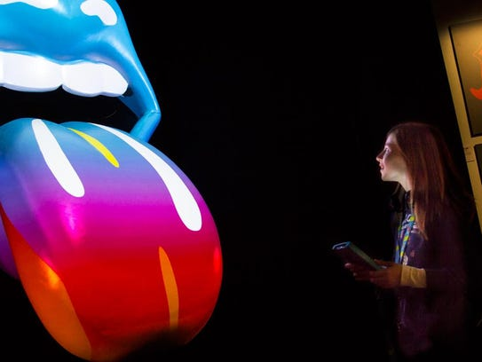 A girl explores The Rolling Stones exhibit at a recent