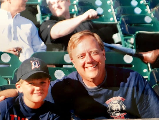 Ronnie and Ron Savage take in a Detroit Tigers game.