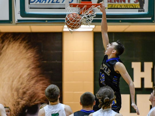 Castle's Alex Hemenway (12) gets a dunk as the Castle Knights play the North High Huskies for the Class 4A Sectional Championship at North Saturday, March 3, 2018.