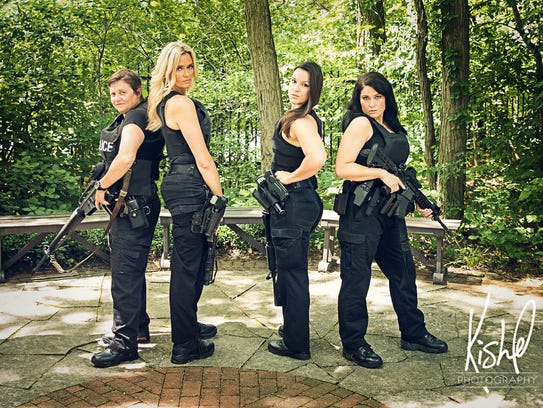 Muncie Police Department officers (left to right) Linda