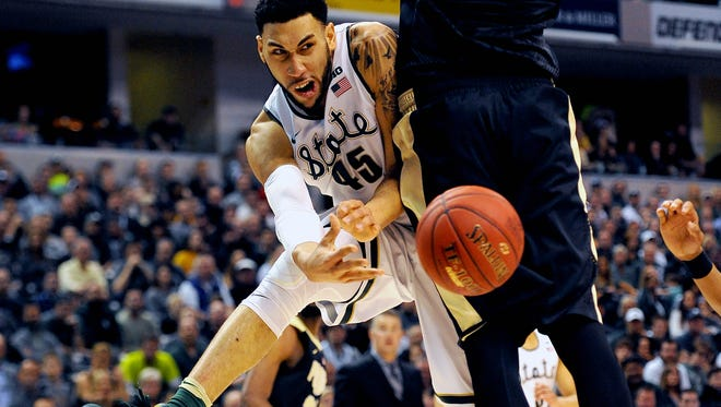 Michigan State senior guard Denzel Valentine (45) passes around Purdue  center A.J. Hammond (20) to a teammate during the Big Ten tournament championship Sunday in Indianapolis. Valentine finished with 15 points, 10 rebounds and nine assists.