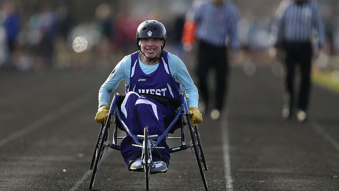 Green Bay West junior Mitchell Kaquatosh competes in the 100-meter wheelchair race on April 14 at the Green Bay City track and field meet at Green Bay East High School.
