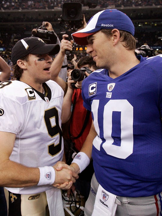 FILE - In this Oct. 18, 2009, file photo, New Orleans Saints quarterback Drew Brees (9) and New York Giants quarterback Eli Manning (10) shake hands after an NFL football game in New Orleans. Brees and Manning are friends off the field and rivals on the field. On Sunday, the two high-profile quarterbacks go at it when Brees' Saints take on Manning's Giants. (AP Photo/Patrick Semansky, File)