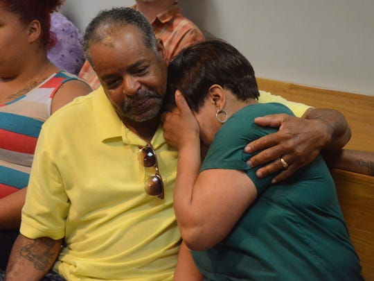 The parents of Breon Williams -- Jeffrey Williams and Tammy McCray -- embrace after the verdict was announced.