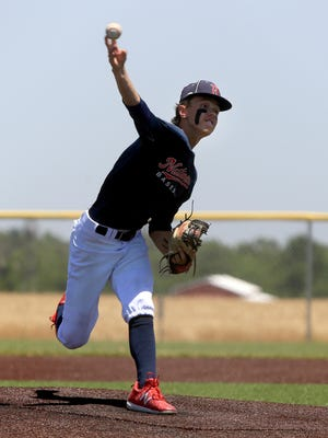 Buhler Nationals' Bradley Neill (9) pitches Saturday against the Kansas Curve during the championship game of the Battle of the Wheat tournament in Buhler. Kansas Curve defeated Buhler Nationals 5-4.