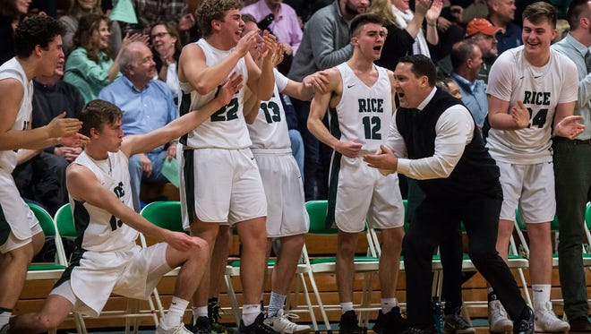 Right, Head Coach Paul Pecor celebrates as his team makes up a 13-point deficit during their semi-final boys basketball match up at Rice in South Burlington on Friday night, March 9, 2018. In a stunning come back, Rice won 62-61.