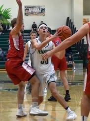 Pennfield's Kyle Liggett (30) eyes the basket during