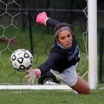A Haslett penalty shot gets past Okemos goal keeper Caroline Serkaian in the second half for the game-winner in their CAAC Gold Cup semifinal game Tuesday, May 19, 2015, in Okemos, Mich. Haslett won 2-1.