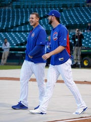 Cubs stars Anthony Rizzo, left, and Kris Bryant combined