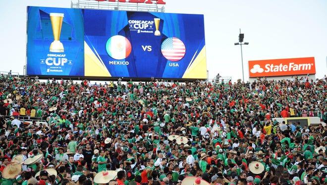 Mexico fans cheer as starters are announced before the game against USA in the CONCACAF Cup at Rose Bowl.