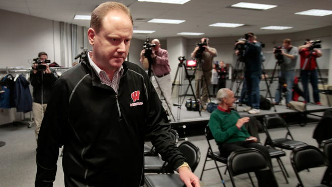 Wisconsin interim head coach Greg Gard arrives for an NCAA college basketball press conference at the Kohl Center in Madison on Wednesday. Bo Ryan, the team's head coach since 2001, announced his retirement Tuesday after his team's win over Texas A&M Corpus Christi.