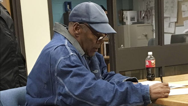 This image released by the Nevada Department of Corrections shows O.J. Simpson signing documents and leaving Lovelock Correctional Centre in Lovelock, Nevada, early on October 1, 2017.