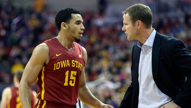 Iowa State guard Naz Long (15) talks with coach Fred Hoiberg after being called for a technical foul during the second half Saturday. Long had 13 points, three rebounds and three steals.