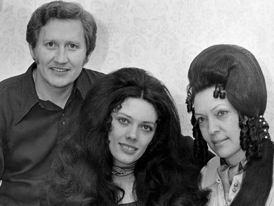 Buck Rambo, left, is with Reba and Dottie Rambo of