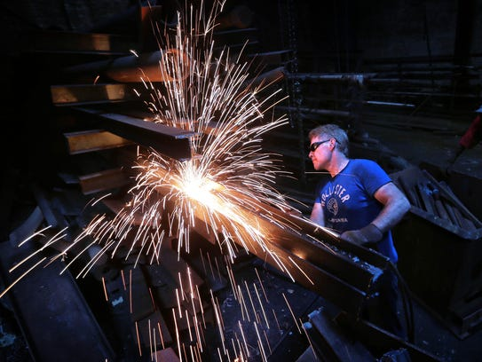 Joey Brown cuts scrap iron into manageable pieces at