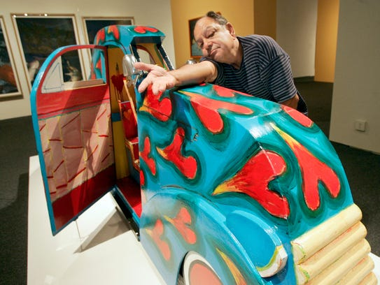 """Cheech Marin poses with """"Heart-Flamed Blue Carrito,"""