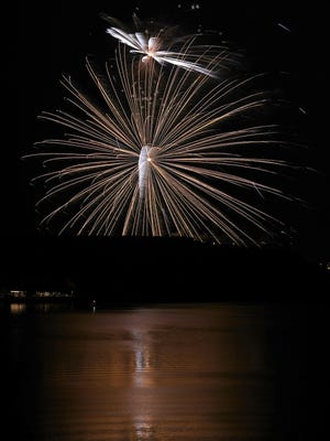 Fireworks explode in the sky during the Fireworks Extravaganza at Buffalo Springs Lake, Tuesday, July 3, 2018, in Lubbock, Texas.