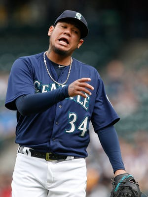 Mariners starting pitcher Felix Hernandez reacts after walking a batter last season. He went 11-8 with a 3.82 ERA.