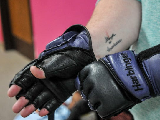 Rachael Smith dons the gloves used in her cardio kickboxing