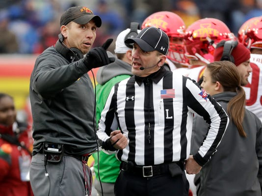 Iowa State head coach Matt Campbell, left, argues a call with line judge Jim Slayton in the second half of the Liberty Bowl NCAA college football game against Memphis, Saturday, Dec. 30, 2017, in Memphis, Tenn. Iowa State won 21-20. (AP Photo/Mark Humphrey)