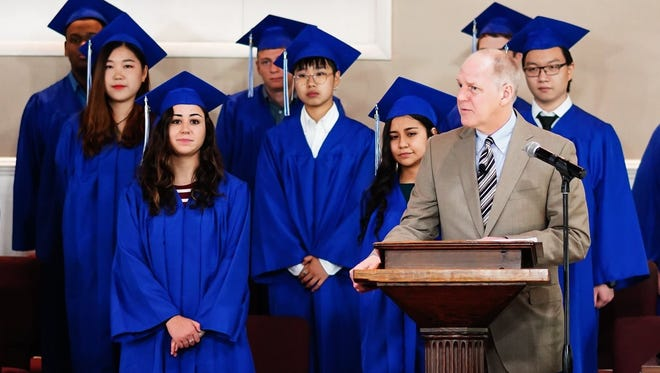 Principal Timothy J. Hostetter speaks at the beginning of Tabernacle Christian Academy's commencement ceremony on June 16.