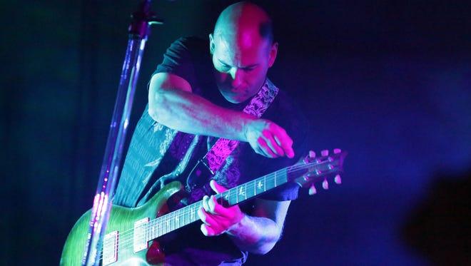 Robb Szymik of Half Empty performs at the Stone Toad in Menasha.