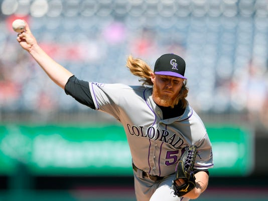 Colorado Rockies starting pitcher Jon Gray delivers a pitch during the first inning of a baseball game against the Washington Nationals, Saturday, April 14, 2018, in Washington. (AP Photo/Nick Wass)