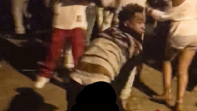 This video still shows the suspect responsible for shooting and wounding six people at a block party.