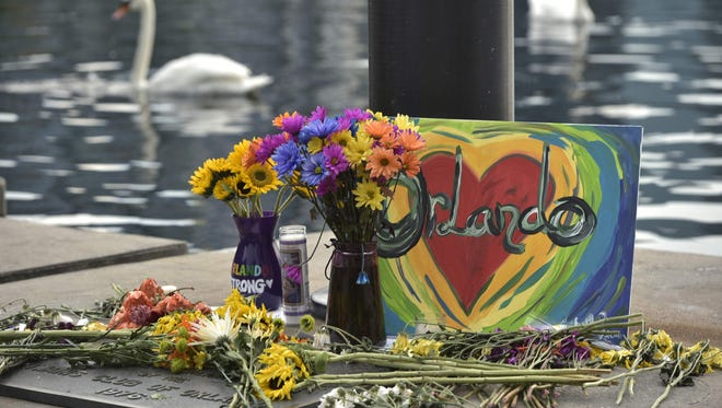 A makeshift memorial for the victims of the Pulse nightclub shooting is seen Monday at Lake Eola in Orlando, Fla.
