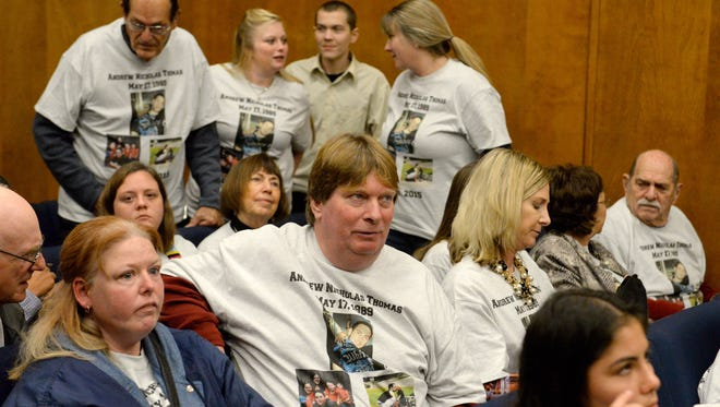 Family members of Andrew Thomas, including his father Edward Thomas, center, react as former Paradise police officer Patrick Feaster is sentenced to three years' probation with 180 days in jail Friday in the death of Andrew Thomas.