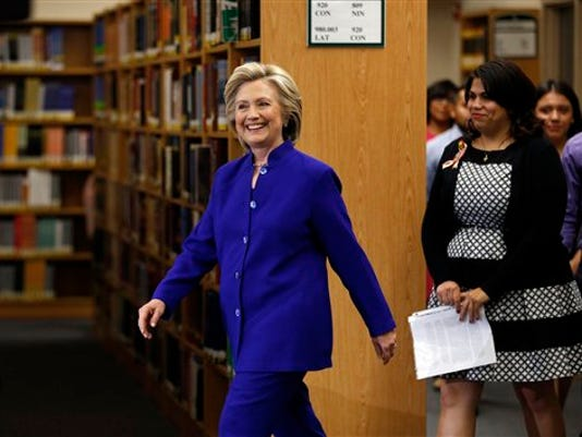 Hillary Rodham Clinton, a 2016 Democratic presidential contender, walks into an event at Rancho High School Tuesday, May 5, 2015, in Las Vegas.