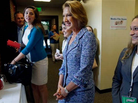 Republican presidential candidate, businesswoman Carly Fiorina, arrives for a forum for most of the major Republican candidates, Monday, Aug. 3, 2015, in Manchester, N.H. The Republican Party's jam-packed presidential class faces off Monday night in New Hampshire, where more than a dozen White House hopefuls aim to warm up for the first full-fledged debate of the primary season. (AP Photo/Jim Cole)