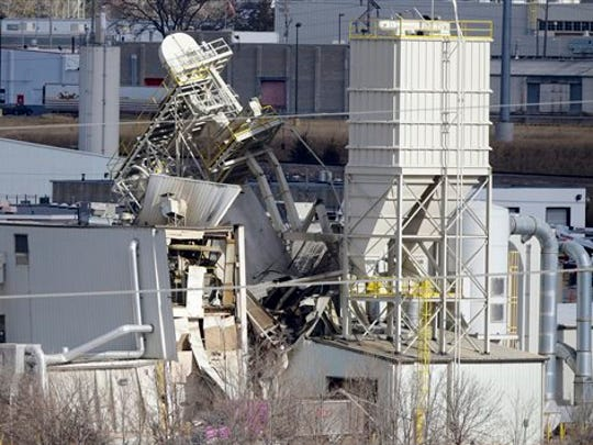 The International Nutrition plant is shown with wreckage in Omaha, Neb., where a fire and explosion took place Monday. At least nine people have been hospitalized and others could be trapped at the animal feed processing plant.