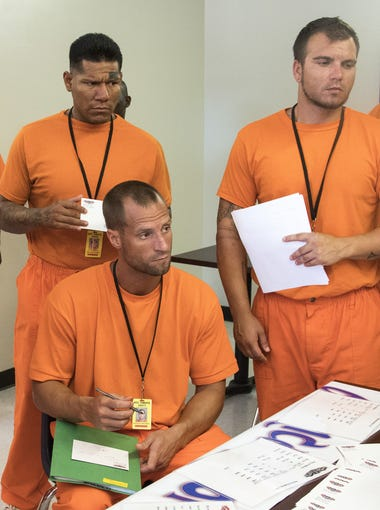 Prison inmates meet employers to fill out job applications at Sunrise Employment Center in Lewis Prison in Buckeye. The state Department of Corrections has partnered with the state Department of Economic Security to begin programs at three prisons, including its women's facility, to help inmates leaving the system get a job. The goal: lower the 39 percent recidivism rate.