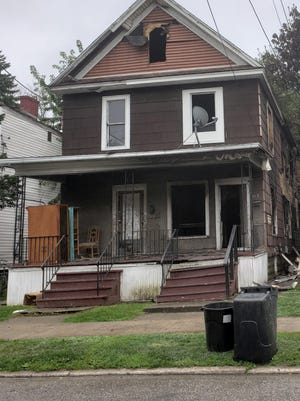 This two-unit house in the 500 block of East 25th Street was heavily damaged in a Wednesday night fire.