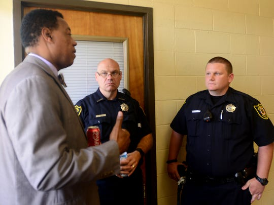 Jackson-Central Merry Principal Dr. Charles Clark speaks with Madison County Deputies and JCM's SRO's Bill Young and Andrew Hackett, Thursday during school hours.