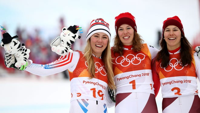 Silver medal winner Mikaela Shiffrin (USA), left, gold medal winner Michelle Gisin (SUI) and bronze medal winner Wendy Holdener (SUI) celebrate their victories in the ladies alpine skiing combined event.
