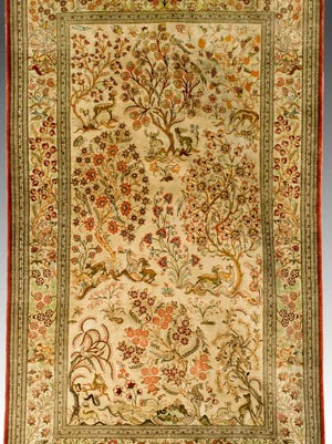 A signed Iranian silk hunting scene rug recently sold for $3,000 at J. Levine's auction.