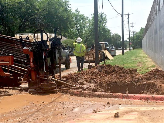 Crews work to repair a water main break outside of Wichita Falls High School on Monday, May 14, 2018.