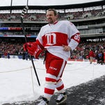 Petr Klima walks to the ice rink  prior to the start of the first game at the Alumni Showdown between the Red Wings and Maple Leafs at Comerica Park in Detroit on Dec. 31, 2013.