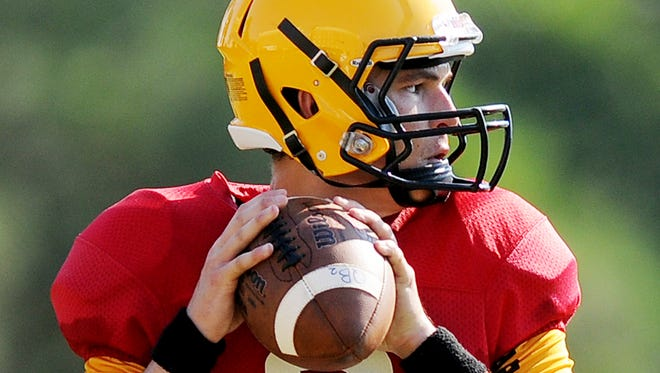 Univerisity of Southern Mississippi's quarterback Nick Mullens looks to throw a pass Friday during football practice at the University's Joe P. Park Practice Facility.