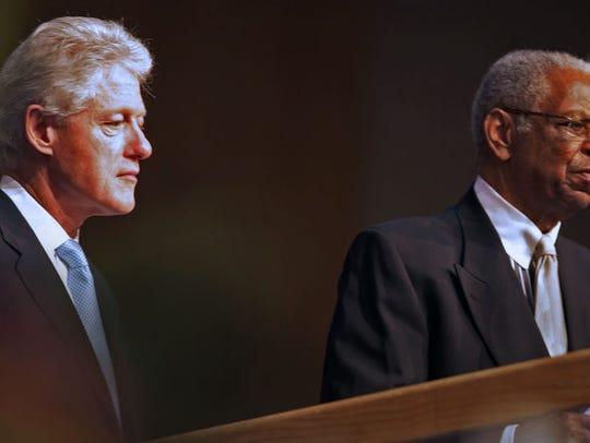 Former President Bill Clinton waits as Judge Damon