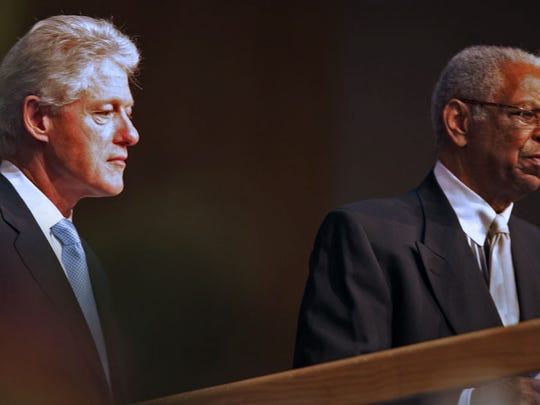 Former President Bill Clinton waits as Judge Damon Keith of Detroit introduces him to speak at the funeral of Rosa L. Parks at Greater Grace Temple Wednesday, Nov. 2, 2005.