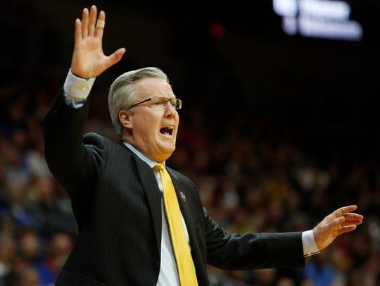 Iowa head coach Fran McCaffery yells to players as