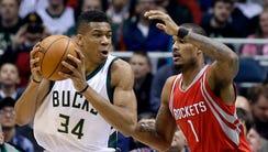 Milwaukee Buck Giannis Antetokounmpo spins against