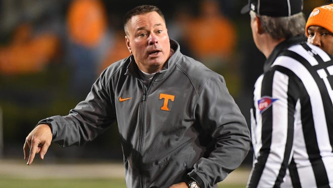 Tennessee coach Butch Jones questions a call during the second half against the Vanderbilt Commodores at Vanderbilt Stadium on Nov. 26, 2016.