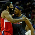 Jan 5, 2015; New Orleans, LA, USA; Washington Wizards forward Nene Hilario (left) celebrates with forward Paul Pierce during a break in the action in the fourth quarter of a game at the Smoothie King Center. The Wizards defeated the Pelicans 92-85.  Mandatory Credit: Derick E. Hingle-USA TODAY Sports